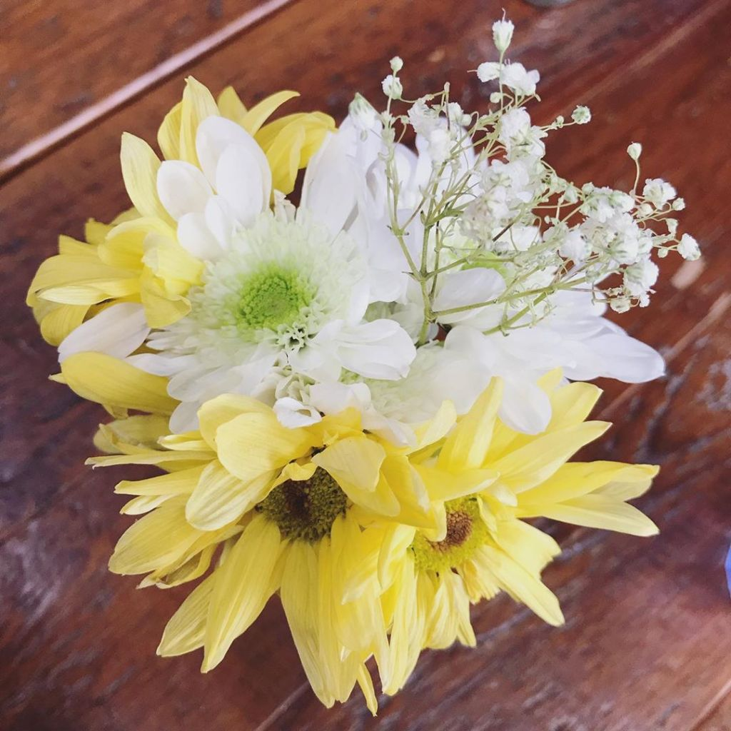 yellow and white flowers with baby's breath